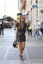 silvia garcia looks absolutely stunning in her diagonal zip leather mini skirt paired with buckled booties