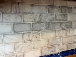 clean grout from marble tile kitchen backsplash