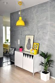 these somewhat old school sponge painted walls look fresh with untra modern furniture