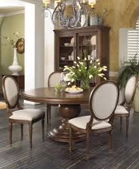 round black glass dining table brown steel pedestal base furniture designs stun room set ideas collection wood and chairs candle centerpieces for tables