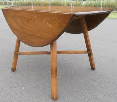 sold oval dropleaf elm dining table by ercol oval drop leaf dining table