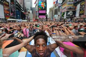Bernice Acosta and other enthusiast perform yoga in Times Square ...