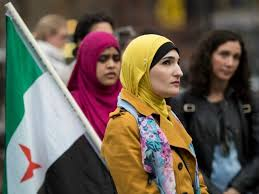 Image result for Linda Sarsour, Marc Lamont Hill photos