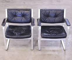 pair of black leather office chairs for waiting area reception etc
