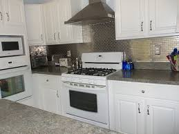 stainless steel backsplash with shelf stainless chimney built in oven white blind light brown wall painted