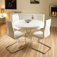 modern round dining table sets for elegant home interior design with wood flooring and fireplace