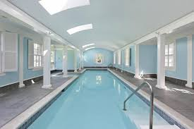 indoor pool and hot tub. Large Indoor Pool And Hot Tub In Light Blue Walls White Support Beams