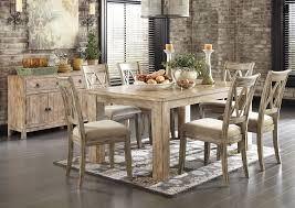 mestler washed brown rectangular dining table w 4 antique white upholstered side chairssignature