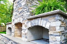 custom veneer outdoor fireplace with built in wood storage boxes cleveland
