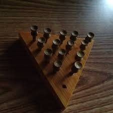 Wooden Peg Board Game What is this game with pegs in holes jumping and capturing each 39