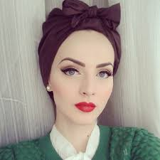 this is the kind of makeup i want to do the striking red lips and the eyeliner i will also run a mid brown tone through to crease to define it