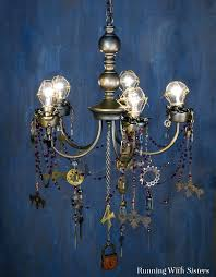 turn a thrift chandelier into a steampunk chandelier with gears keys and clock