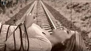 Girl tied to tracks