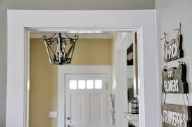 diy door molding we installed ourselves white trim along a gray painted wall