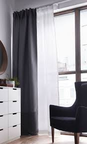 layering a black out curtain with a sheer curtain lets you decide how much light you want to let in while keeping things private