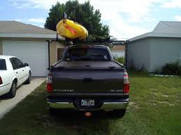 A Heavy Duty Truck Bed Cover And Kayak Rack On A Toyota Tu… | Flickr