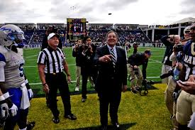 u s department of defense photo essay defense secretary leon e panetta conducts the ronald reagan centennial national football coin toss
