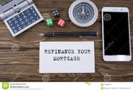 calculator refinance mortgage refinance your mortgage written on paper wooden background desk