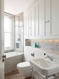 tile floor bathroom. ornate porcelain tile medium tone wood floor bathroom photo in london with a console sink, o