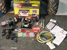warn atv snow plow product review photos motorcycle usa a winch is a must for a working or play atv or utv and it is required to use the plow the investment will be worth it as you use it during