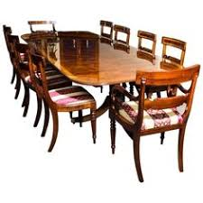 a beautiful regency style dining set which prises a flame gany twin pillar dining table and