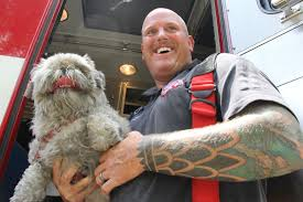 PHOTO GALLERY: House fire on Wood Haven Drive - Flagler County Paramedic Ivan  Grant resuscitated Muffy, a blind dog, after crews saved her from the  burning house.   Palm Coast Observer