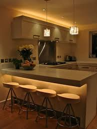 contemporary kitchen with under counter and above cabinet lighting above cabinet lighting