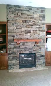stone veneer cost per sqft to install on fireplace surround around gas installing over painted brick