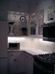 kitchen cabinet led lighting. Inside Cabinet Lighting Picture Of Glass Front Kitchen Cabinets With Decorative Puck Lights Led . P