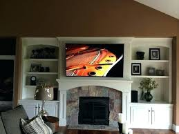 tv mounting on fireplace mounted over fireplace curved television mount above fireplace transitional living room mounted