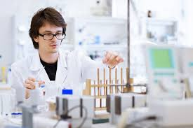 Young Male Researcher Chemistry Student Carrying Out Scientific