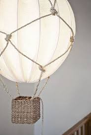 a beautiful hot air balloon lamp using rope and an ikea regolit lampshade is a gorgeous