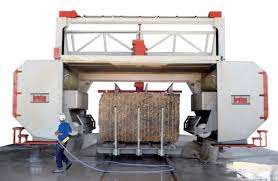 block of granite being cut into slabs on a breton diamond wire saw