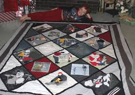 Remembering Dad - A Quilt for Two Young Boys • Rhino Quilting & Lucas with his quilt made from father's clothes Adamdwight.com