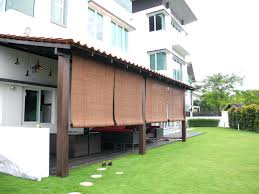 outdoor window shades exterior brown bamboo roll up blind hanging on wooden deck source roof among
