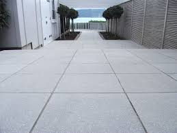 create a stylish patio with large poured concrete pavers intended