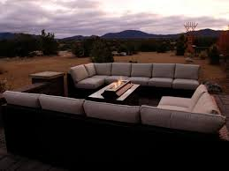 gray patio seating area with modern outdoor fireplace