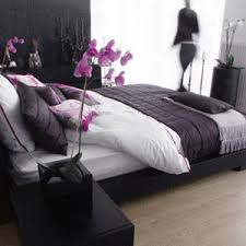 purple black grey white bedroom. this bamboo colored flooring is nice. love  the abstract