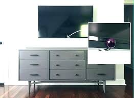 hide tv furniture. Hiding Tv Stand That Hides How To Hide Cords On Wall Mounted Above Fireplace A . Furniture