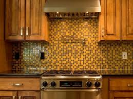 Yellow And Brown Mosaic Kitchen Backsplash Wooden Varnished Cabinet  Electric Stove Hanging Range Hood Gold Stainless Steel Pull Handler Luxury  For Interior ...