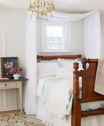 From Better Homes and Gardens: drape a piece of fabric over two swing-arm  curtain rods, mounted on either side of the bed, for a super-easy canopy.