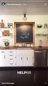 the wall above a kitchen sink with