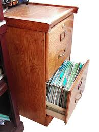 messy file cabinet. English: Wooden File Cabinet With Drawer Open. Messy