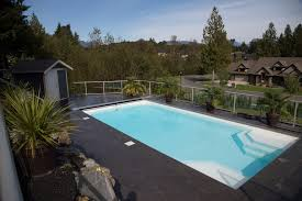 vancouver inground fiberglass with contemporary tiki torches pool modern and outdoor living swimming
