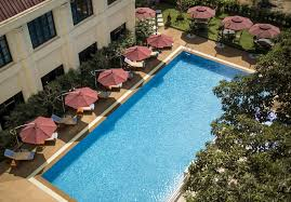 a view of the pool at rose garden hotel or nearby