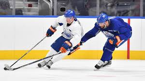 for the second straight day oilers players faced off in a scrimmage on the main rogers place ice drake caggiula scored 33 seconds into three on three