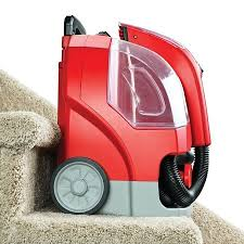 rug doctor portable spot cleaner machine red corded on stairs