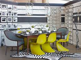 concrete flooring in cool eclectic dining room design with gallery wall and window treatments also decorating with lanterns and zebra rug plus narrow dining