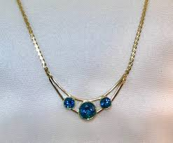 custom designed 14 kt yellow gold and london blue topaz bezel three stone pendant