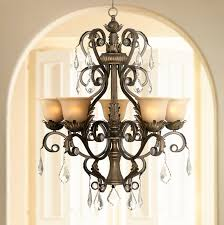 a beautiful traditional chandelier with five lights behind amber glass plus a center downlight from the kathy ireland lighting collection